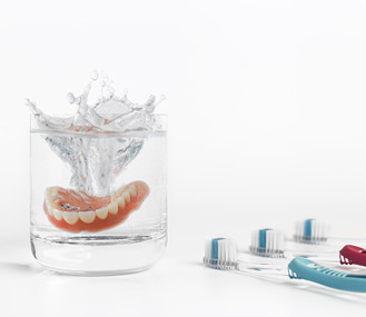 Denture with a Glass